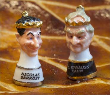 Two figurines representing France's President Nicolas Sarkozy (L) and Strauss-Kahn.