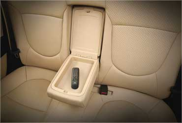 Rear seat armrest with hand audio remote.
