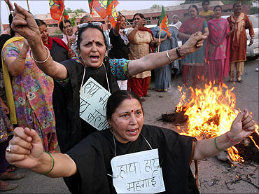 BJP activists shout anti-government slogans during a protest against a recent hike.