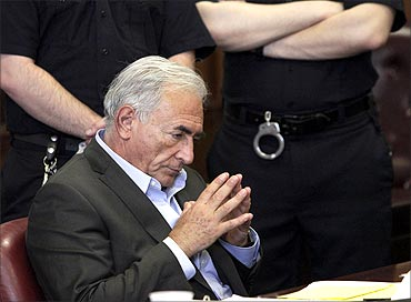 Former IMF chief Dominique Strauss-Kahn gestures during his bail hearing inside of the New York State Supreme Courthouse in New York.