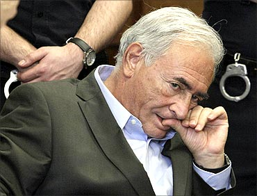 Former IMF chief Dominique Strauss-Kahn listens to his lawyer, Williams Taylor.