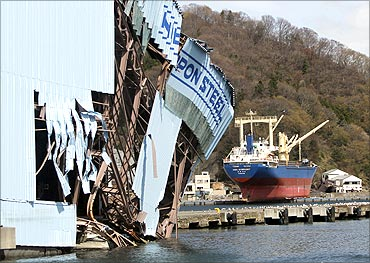 Damaged Nippon Steel's facility (L) and a cargo ship swept by ashore by Tsunami.