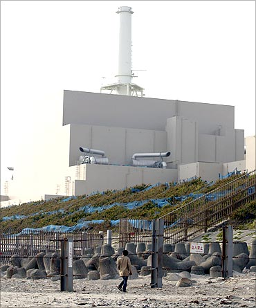 A man looks at Chubu Electric Power's Hamaoka Nuclear Power Station in Omaezaki.