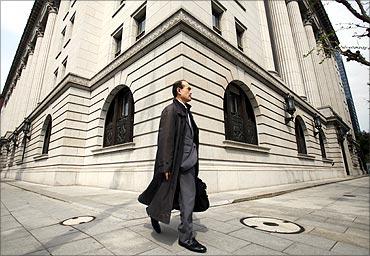 A man walks past insurance company Meiji Yasuda Life in Tokyo.