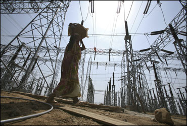 A labourer works at the construction site of a grid power station in Jammu.