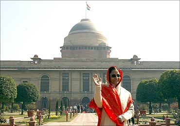 President Pratibha Patil waves to photographers from the famous Mughal Garden.