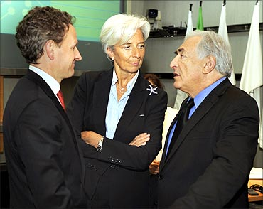 (L-R) Timothy Geithner, Christine Lagarde and Strauss-Kahn chat prior to a meeting in April.