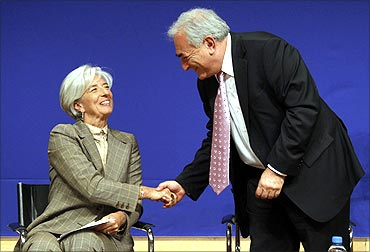 Christine Lagarde (L) shakes hands with Dominique Strauss-Kahn at a conference in June, 2010.