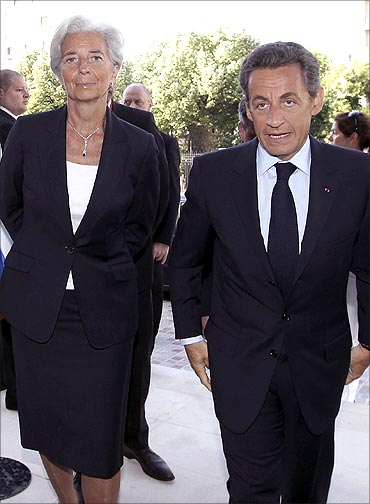 France's Finance and Economy Minister Christine Lagarde (R) chats with French President Sarkozy.