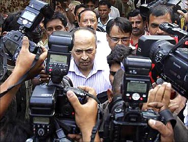 Gautam Doshi, a group managing director of Reliance ADA group, leaves a court in New Delhi.