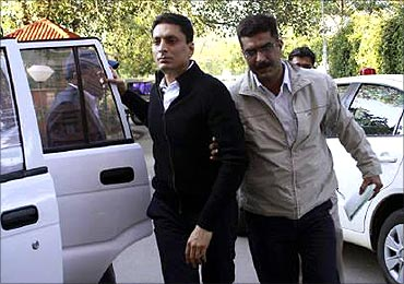 CBI officials escort Shahid Balwa.