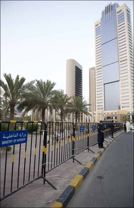 Metal fences are erected at the main square in Kuwait City.