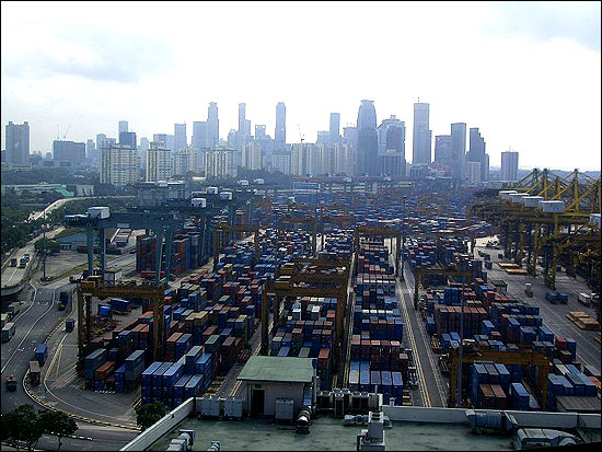 The port of Singapore, one of the world's five busiest, with the skyline of Singapore in the background.