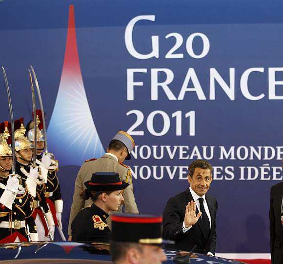 France's President Nicolas Sarkozy arrives at the G20 venue where world leaders gather in Cannes