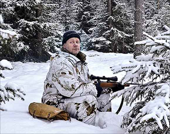 Henrik Widlund looks out during the wolf hunt in Hasselforsreviret, central Sweden.