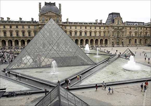 The general view of the Louvre Museum with its glass Pyramid entrance designed by Chinese-born US Architect I.M. Pei.