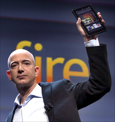 Amazon CEO Jeff Bezos holds up the new Kindle Fire.