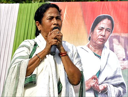 Mamata Banerjee addresses her supporters during an election campaign rally.