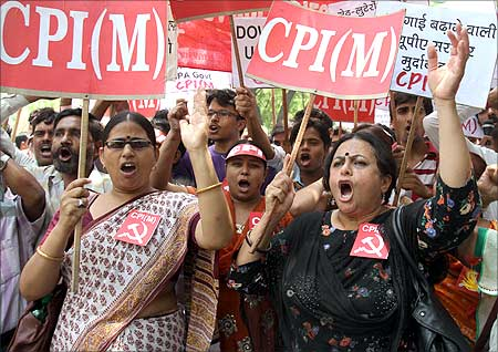Activists from the Communist Party of India-Marxist (CPI-M) shout slogans during a protest against the hike in fuel prices in New Delhi.