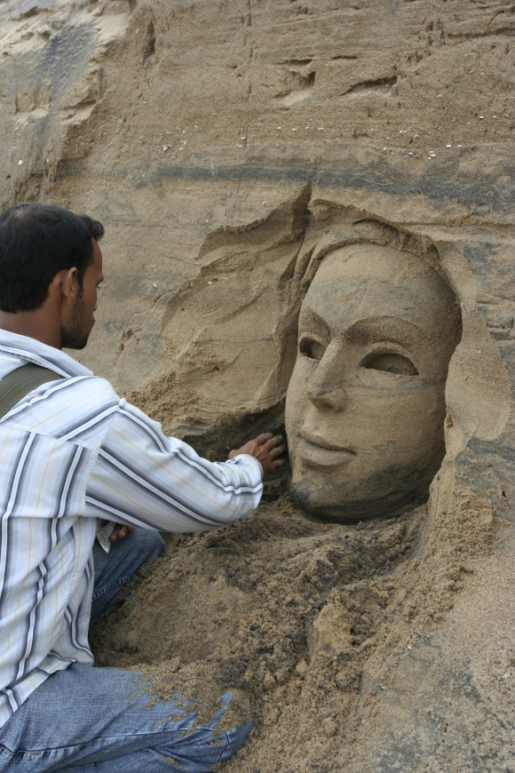 An artist works on a sculpture in Puri, Orissa.