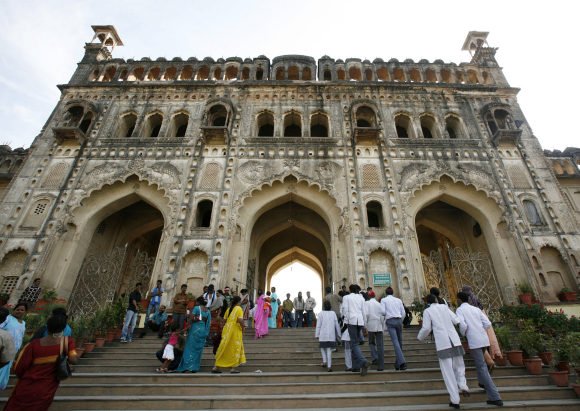 isitors walk towards the main entrance of the Asafi Imambara monument, also known as Bara Imambara, in Lucknow.