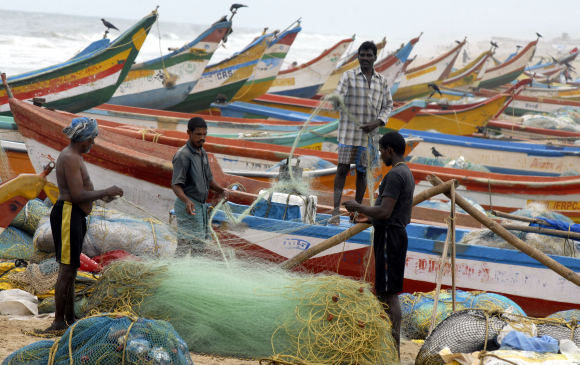 Fishermen work at Marina Beach in Chennai.