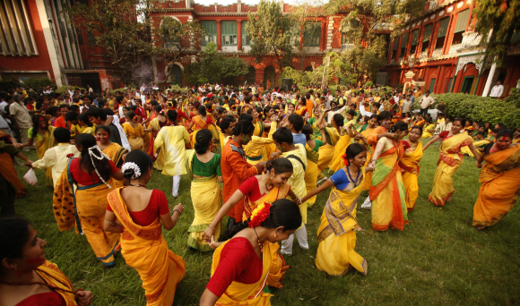 Students from Rabindra Bharati University dance as they celebrate Basanta Utsab, or Spring Festival, in Kolkata.