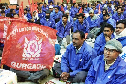 Employees of Maruti Udyog listen to a speaker in New Delhi.