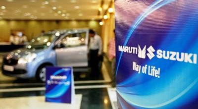 A customer stands inside a Maruti Suzuki's car showroom in Ahmedabad.