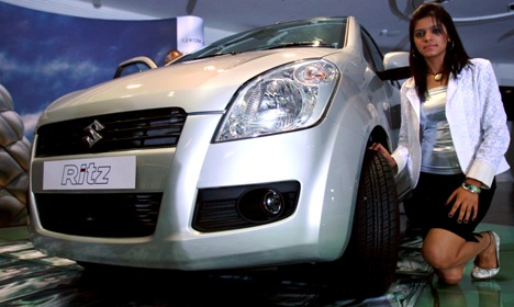 A model poses with the Ritz car during its launch in New Delhi.
