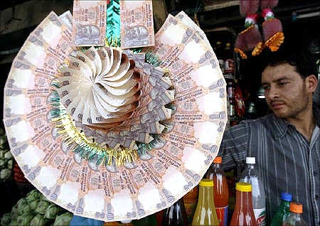 A garland made of rupee notes.