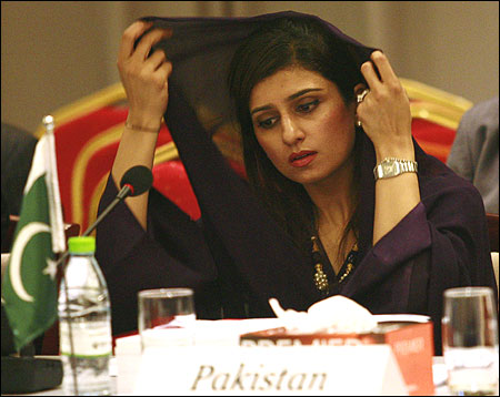 Pakistan's Foreign Minister Khar adjusts her scarf during the SAARC countries foreign ministers meeting in Addu.