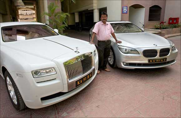 Ramesh Babu with his newly acquired Rolls-Royce and a BMW.