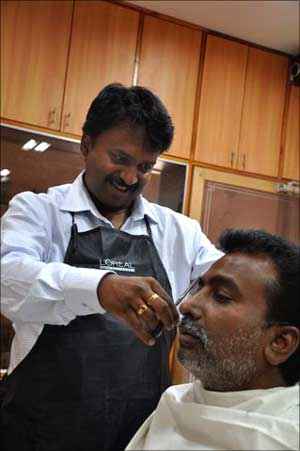 Ramesh Babu at his barber shop.