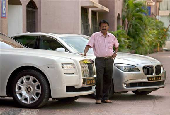 Ramesh Babu with a couple of his luxury cars.