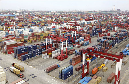 Trucks are driven into a shipping container area at Qingdao port, Shandong.