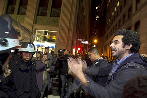 Members of the Occupy Wall St movement clash with New York Police Department officers after being removed from Zuccotti Park in New York.