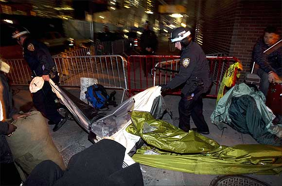 New York Police Department officers remove the belongings of members of the Occupy Wall Street movement after removing members of the movement from Zuccotti Park in New York.