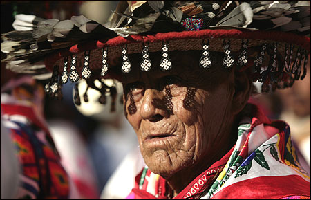 A Huichol elder, wearing a traditional hat, takes part in a protest in Mexico City.