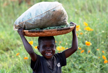 A Malawian child carries a basket outside during a visit by pop star Madonna to the Home of Hope orphanage in Mchinji.