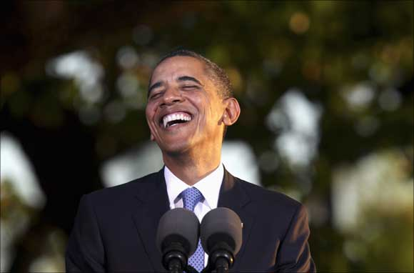 US President Barack Obama laughs during his press conference at the conclusion of the APEC Summit in Honolulu, Hawaii.