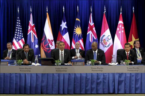 US President Barack Obama (C) speaks at the Trans-Pacific Partnership Leaders meeting at the Hale Koa Hotel during the APEC Summit in Honolulu, Hawaii.