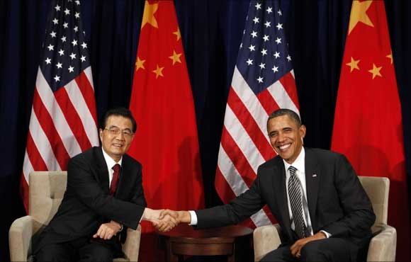 US President Barack Obama and Chinese President Hu Jintao shake hands during the APEC Summit.