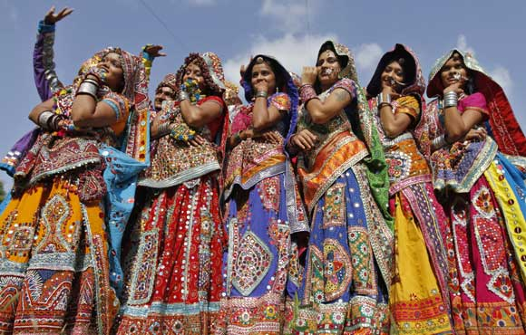 Dancers clad in colourful dresses.