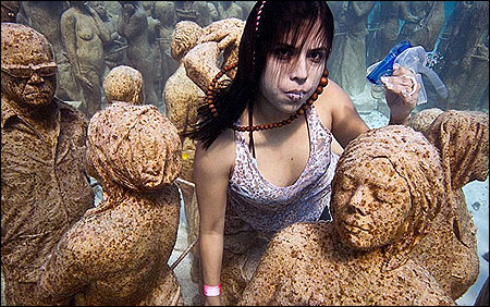 Greenpeace and 350.org stage an underwater installation called 'Silent Evolution' in Cancun.