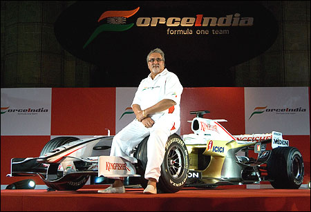 Mallya, poses with the new Force India Formula One Team car on display at the launch held infront of the Gateway of India February 7, 2008 in Mumbai.