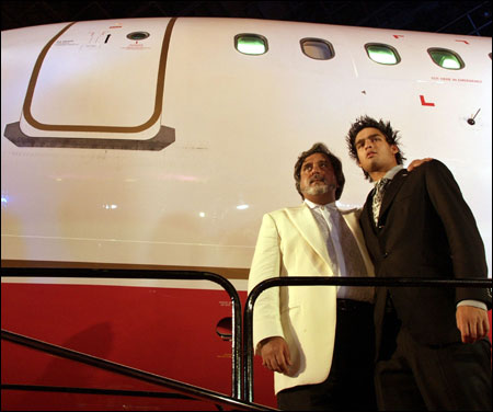 Mallya poses with his son Siddhartha during the launch of Kingfisher Airline in Mumbai on May 7, 2005.