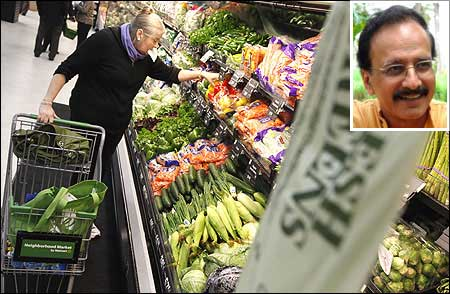 A shopper looks through the produce section in a Walmart Neighborhood Market in Chicago. (Inset) Devinder Sharma.