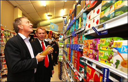 Labour leader Phil Goff and Chris Hipkins discuss food prices at Stokes Valley New World supermarket in Wellington, New Zealand.