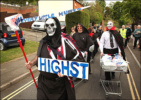 Protestors, dressed as dead shoppers, demonstrate near the location of a proposed Tesco supermarket in Newport Pagnell, England.